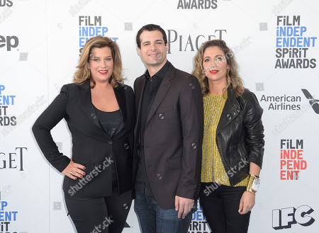 """Stock Image of Alice Weinberg, from left, Pouya Shahbazian, and Melissa Hook, producers of """"American Honey,"""" arrive at the Film Independent Spirit Awards, in Santa Monica, Calif"""
