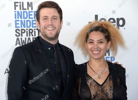 Stock Photo of Craig Shilowich, left, and Melody C. Roscher arrive at the Film Independent Spirit Awards, in Santa Monica, Calif