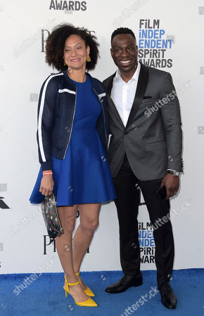 Kira Kelly, left, and Hans Charles arrive at the Film Independent Spirit Awards, in Santa Monica, Calif