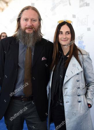 David Mackenzie, left, and Carla Hacken arrive at the Film Independent Spirit Awards, in Santa Monica, Calif