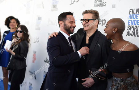 Nick Kroll, from left, Colin Firth, and Oge Egbuonu arrive at the Film Independent Spirit Awards, in Santa Monica, Calif
