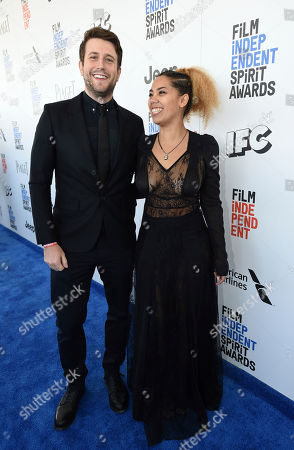 Stock Picture of Craig Shilowich, left, and Melody C. Roscher arrive at the Film Independent Spirit Awards, in Santa Monica, Calif