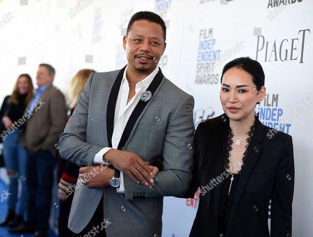 Terrence Howard, left, and Miranda Pak arrive at the Film Independent Spirit Awards, in Santa Monica, Calif