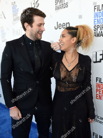 Craig Shilowich, left, and Melody C. Roscher arrive at the Film Independent Spirit Awards, in Santa Monica, Calif