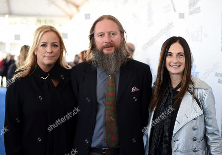 "Stock Image of Producer Julie Yorn, from left, director David Mackenzie, and producer Carla Hacken, from ""Hell or High Water,"" arrive at the Film Independent Spirit Awards, in Santa Monica, Calif"