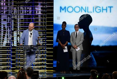"""James Laxton accepts the award for best cinematography for """"Moonlight"""" at the Film Independent Spirit Awards, in Santa Monica, Calif"""