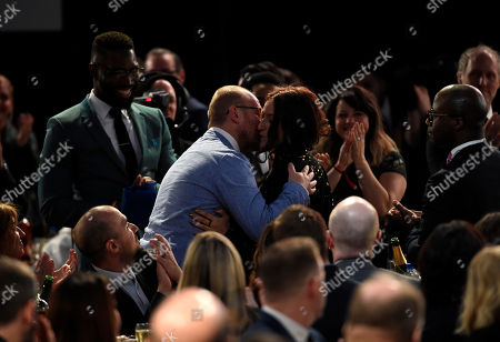 """James Laxton is seen in the audience after winning the award for best cinematography for """"Moonlight"""" at the Film Independent Spirit Awards, in Santa Monica, Calif"""