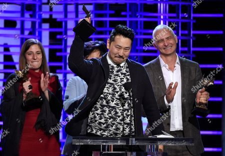 "Andrew Ahn accepts the John Cassavetes award for ""Spa Night"" at the Film Independent Spirit Awards, in Santa Monica, Calif"