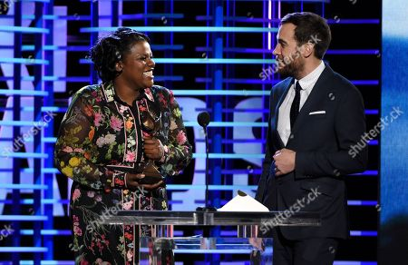 "Joi McMillon, left, and Nat Sanders accept the award for best editing for ""Moonlight"" at the Film Independent Spirit Awards, in Santa Monica, Calif"