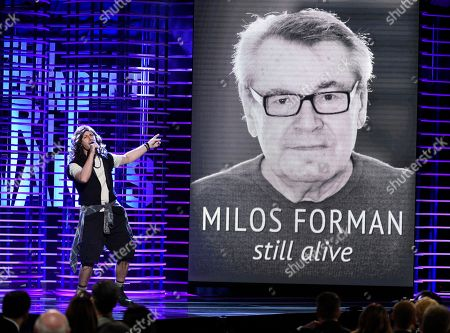 Stock Picture of Andy Samberg performs while Milos Forman is seen on screen at the Film Independent Spirit Awards, in Santa Monica, Calif