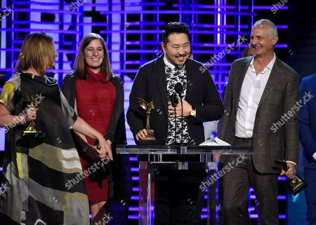 "Kelly Thomas, from left, Giulia Caruso, Andrew Ahn, and David Ariniello accept the John Cassavetes award for ""Spa Night"" at the Film Independent Spirit Awards, in Santa Monica, Calif"