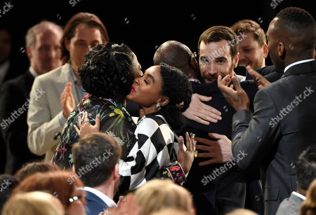 "Joi McMillon and Nat Sanders are seen in the audience after winning the award for best editing for ""Moonlight"" at the Film Independent Spirit Awards, in Santa Monica, Calif"