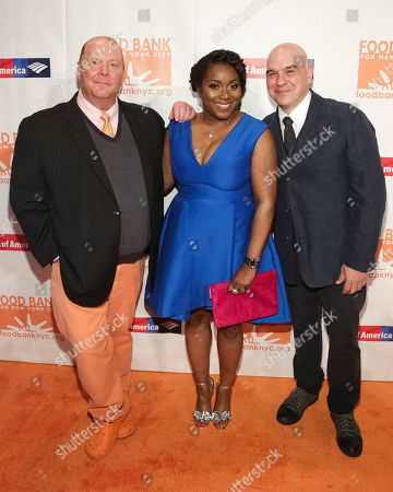 Chef Mario Batali, from left. President/CEO of Food Bank for NYC Margarette Purvis and chef Michael Symon attend the Food Bank for New York City Can-Do Awards at Cipriani Wall Street, in New York