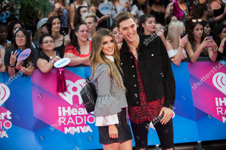 Shenae Grimes-Beech, left, and Josh Beech arrive at the iHeartRadio Much Music Video Awards, in Toronto, Canada