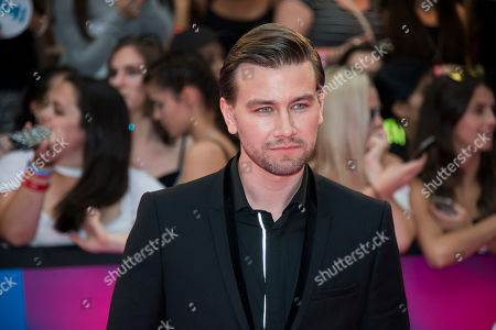 Torrance Coombs arrives at the iHeartRadio Much Music Video Awards, in Toronto, Canada