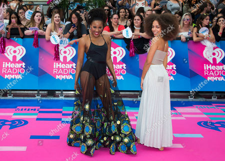 Stock Photo of Asha Bromfield and Hayley Law arrive at the iHeartRadio Much Music Video Awards, in Toronto, Canada