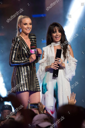 Liz Trinnear presents award for Best New International Artist to Camila Cabello at the 2017 iHeartRadio Much Music Video Awards at Much Music, in Toronto, Ontario