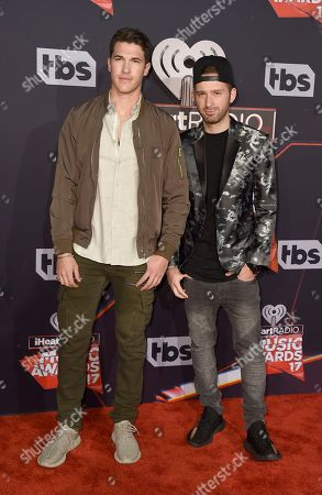 Cal Shapiro, left, and Rob Resnick arrive at the iHeartRadio Music Awards at the Forum, in Inglewood, Calif