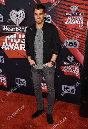 Luke Pell arrives at the iHeartRadio Music Awards at the Forum, in Inglewood, Calif