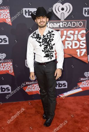 Joss Favela arrives at the iHeartRadio Music Awards at the Forum, in Inglewood, Calif