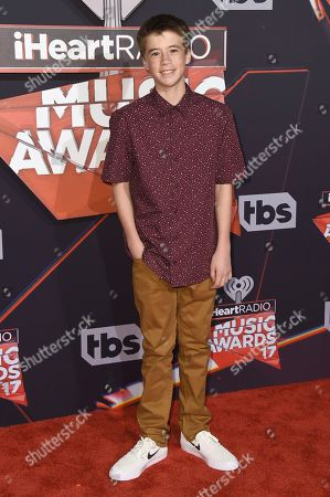 Liam Carroll arrives at the iHeartRadio Music Awards at the Forum, in Inglewood, Calif