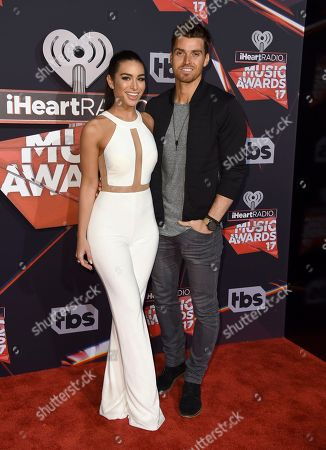 Ashley Iaconetti, left, and Luke Pell arrive at the iHeartRadio Music Awards at the Forum, in Inglewood, Calif