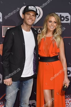 Granger Smith, left, and Amber Bartlett arrive at the iHeartRadio Music Awards at the Forum, in Inglewood, Calif