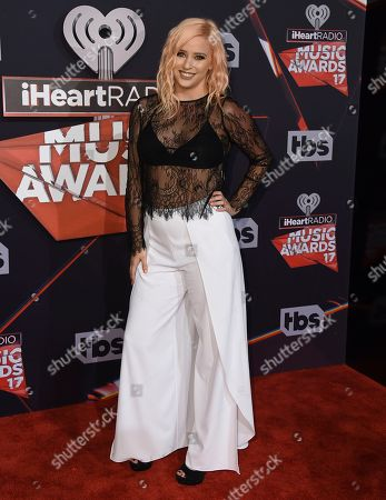 Lily Marston arrives at the iHeartRadio Music Awards at the Forum, in Inglewood, Calif