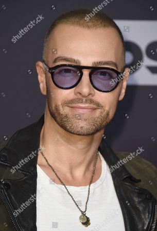 Joey Lawrence arrives at the iHeartRadio Music Awards at the Forum, in Inglewood, Calif
