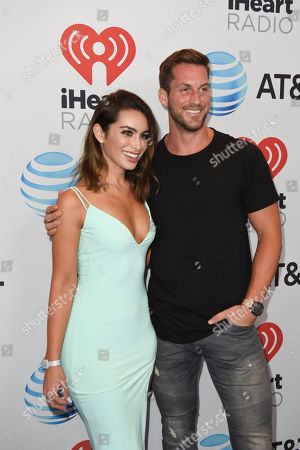 Stock Picture of Ashley Iaconetti, left, and Chase McNary attend the iHeartRadio Summer Pool Party at the Fontainebleau Miami Beach, in Miami Beach, Fla