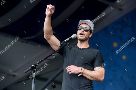 Stock Photo of Amos Lee performs at the New Orleans Jazz and Heritage Festival, in New Orleans