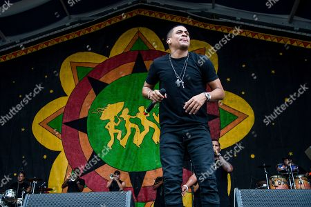 Randy Malcom Martinez of Gente De Zona performs at the New Orleans Jazz and Heritage Festival, in New Orleans