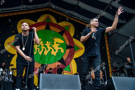 Alexander Delgado, left, and Randy Malcom Martinez of Gente De Zona performs at the New Orleans Jazz and Heritage Festival, in New Orleans