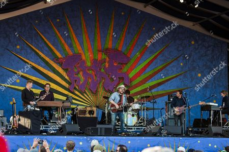 Nels Cline, from left, Mikael Jorgensen, Jeff Tweedy, Glenn Kotche, John Stirratt, and Pat Sansone of Wilco perform at the New Orleans Jazz and Heritage Festival, in New Orleans