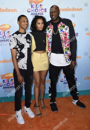 Lamar Odom, from right, and children Destiny Odom, and Lamar Odom Jr arrive at the Kids' Choice Awards at the Galen Center, in Los Angeles