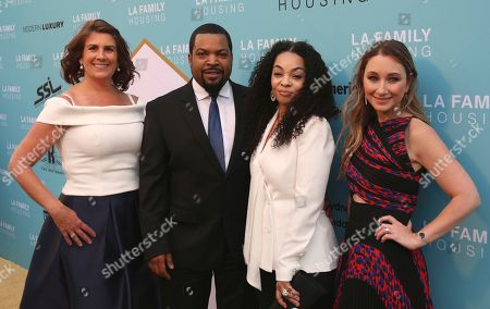 Stephanie Klasky-Gamer, from left, Ice Cube, Kimberly Woodruff, and Blair Rich arrive at the 2017 LA Family Housing Awards at The Lot, in West Hollywood, Calif