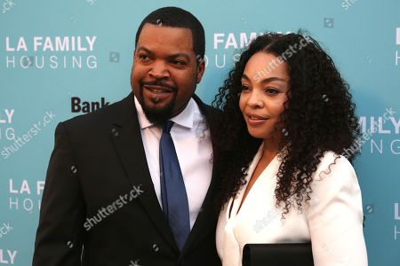 Ice Cube, left, and Kimberly Woodruff arrives at the 2017 LA Family Housing Awards at The Lot, in West Hollywood, Calif