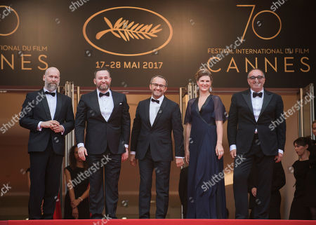 From left, cinematographer Mikhail Krichman, actor Alexey Rozin, director Andrey Zvyagintsev, actress Maryana Spivak and producer Alexander Rodnyansky pose for photographers upon arrival at the screening of the film Loveless at the 70th international film festival, Cannes, southern France