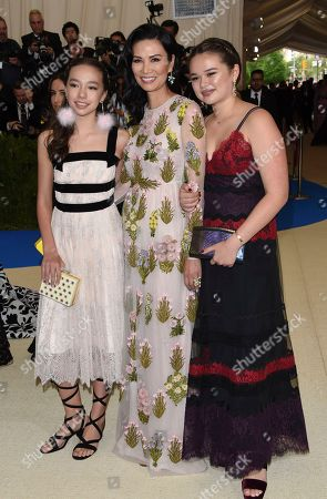 Chloe Murdoch, Wendi Deng, and Grace Helen Murdoch attend The Metropolitan Museum of Art's Costume Institute benefit gala celebrating the opening of the Rei Kawakubo/Comme des Garçons: Art of the In-Between exhibition, in New York