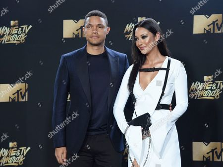Trevor Noah, left, and Jordyn Taylor arrive at the MTV Movie and TV Awards at the Shrine Auditorium, in Los Angeles