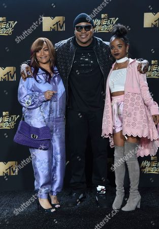 Stock Image of Simone Smith, from left, LL Cool J and Nina Simone Smith arrive at the MTV Movie and TV Awards at the Shrine Auditorium, in Los Angeles