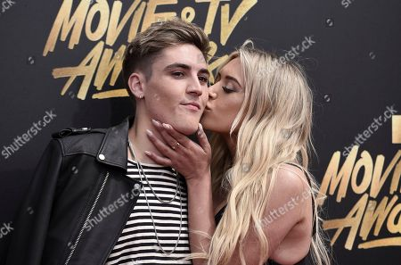 Sammy Wilk, left, and Anastasia Karanikolaou arrive at the MTV Movie and TV Awards at the Shrine Auditorium, in Los Angeles