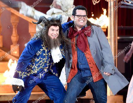 Adam Devine, left, and Josh Gad perform at the MTV Movie and TV Awards at the Shrine Auditorium, in Los Angeles