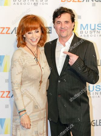 Reba McEntire, left, and Scott Borchetta arrive at 2017 Music Biz - Music Business Artist Awards Luncheon at Renaissance Nashville Hotel, in Nashville, Tenn