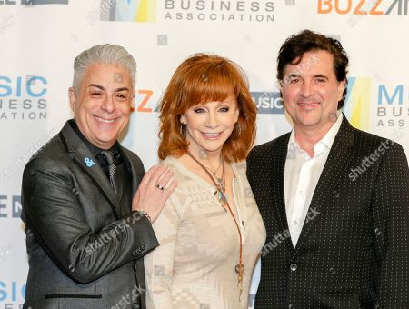 Jim Donio, left, Reba McEntire, and Scott Borchetta arrive at 2017 Music Biz - Music Business Artist Awards Luncheon at Renaissance Nashville Hotel, in Nashville, Tenn