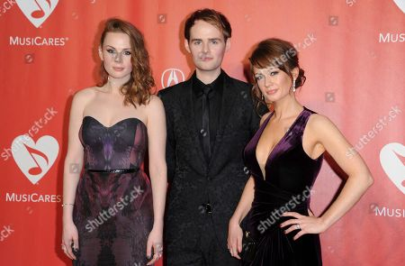 Stock Image of Roseanna Brown, from left, Jonathan Brown and Alanna Brown, of The Rua, arrive at the MusiCares Person of the Year tribute honoring Tom Petty at the Los Angeles Convention Center on