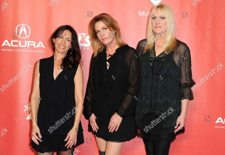 Susanna Hoffs, from left, Vicki Peterson and Debbi Peterson, of The Bangles, arrive at the MusiCares Person of the Year tribute honoring Tom Petty at the Los Angeles Convention Center on