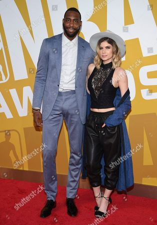 NBA player Rasual Butler, left, and Leah LaBelle arrive at the NBA Awards at Basketball City at Pier 36, in New York