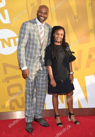 Stock Picture of NBA player Vince Carter, of the Memphis Grizzlies, left, and Kai Michelle Carter arrive at the NBA Awards at Basketball City at Pier 36, in New York