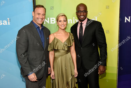 """Matt Iseman, left, Kristine Leahy, center, and Akbar Gbajabiamila, cast members in the NBC series """"American Ninja Warrior,"""" poses at the 2017 NBCUniversal Summer Press Day at the Beverly Hilton, in Beverly Hills, Calif"""